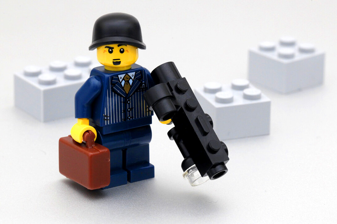 Image of lego business man holding a black gun. Phoenix company directors are essentially criminals in nice suits.